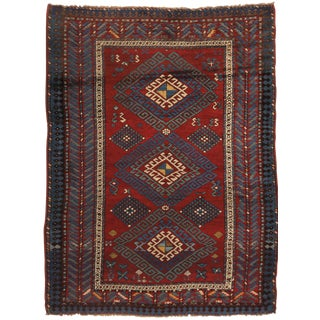 Antique Kazak Transitional Geometric Red and Blue Wool Rug With Dyrnak Guls - 4′5″ × 6′ For Sale