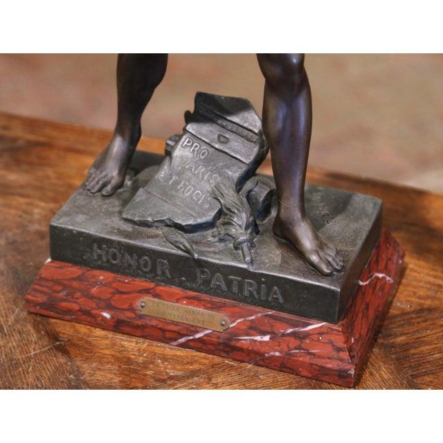 Decorate a gentleman's study or l'office with this antique figure. Sculpted in France, circa 1880, the spelter statue...