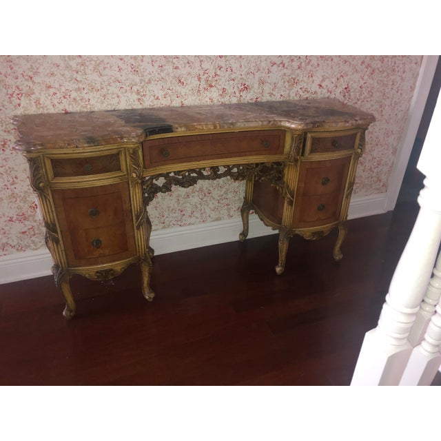 This is a very nice marble Top Vanity in walnut sitting on 8 French style cabriole legs. Carvings to the center with a...
