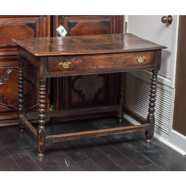 English oak side table with single drawer and bobbin turned legs, circa 1780 height: 29 in. (74 cm) width: 39 in. (99 cm)...