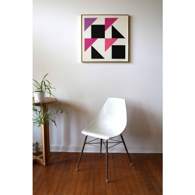 Vintage 1960's hard edge abstract oil painting by mid century artist, Carl Slaughter. This painting features pink, purple,...