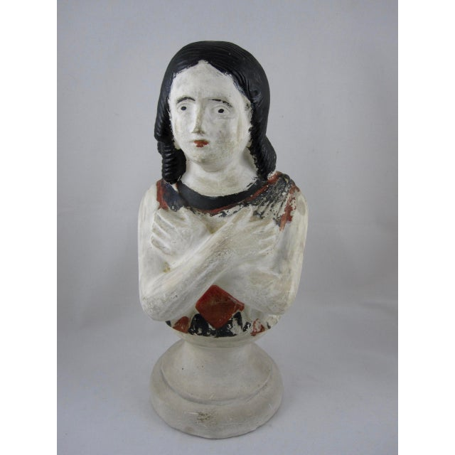 A scarce 19th Century Pennsylvania Chalkware bust – a figure of a girl. Highlighted with polychrome painting, this...