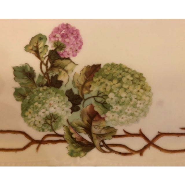 Stunning colors and hand painted floral motif.