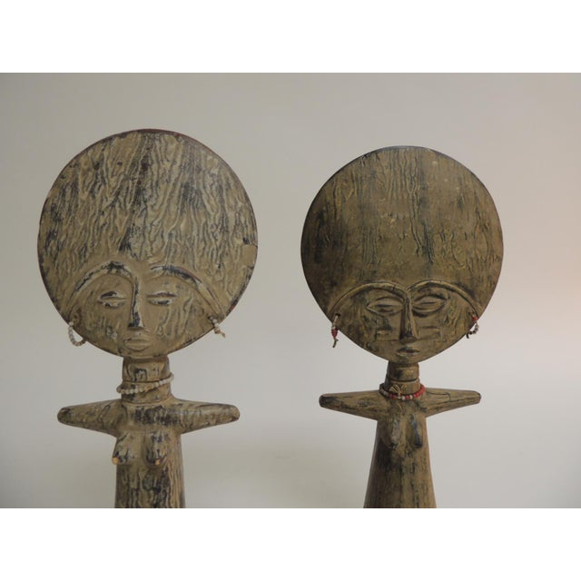 Pair of African Asante Akua'ba fertility dolls with glass beads adornments Size: 13 x 6 x 2.5 Condition: Minor loss on one...
