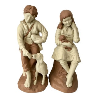 Pair Ceramic Boy & Girl With Puppies For Sale