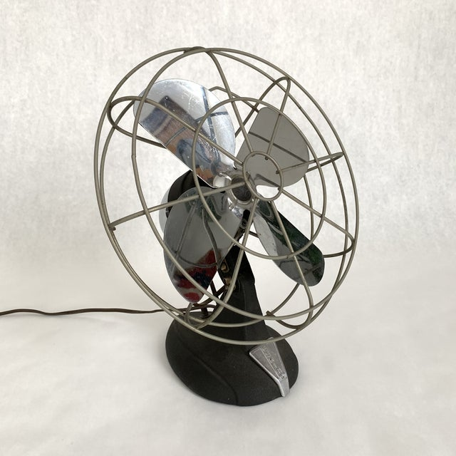 Electric Eskimo table fan with metallic chrome blades and cast iron base. When plugged in it does work, but I would...