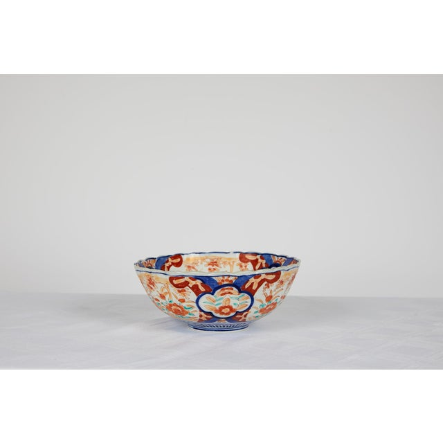 Early 20th century Japanese Imari scalloped bowl with a center medallion surrounded by alternating floral decorations hand...
