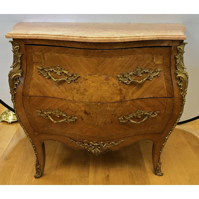 Antique French marquetry bombe chest with marquetry, inlay and bronze ormolu mounts. Has two large drawers. Condition:...