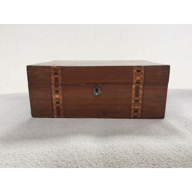 Tunbridge ware is a form of decoratively inlaid woodwork, typically in the form of boxes, that is characteristic of the...