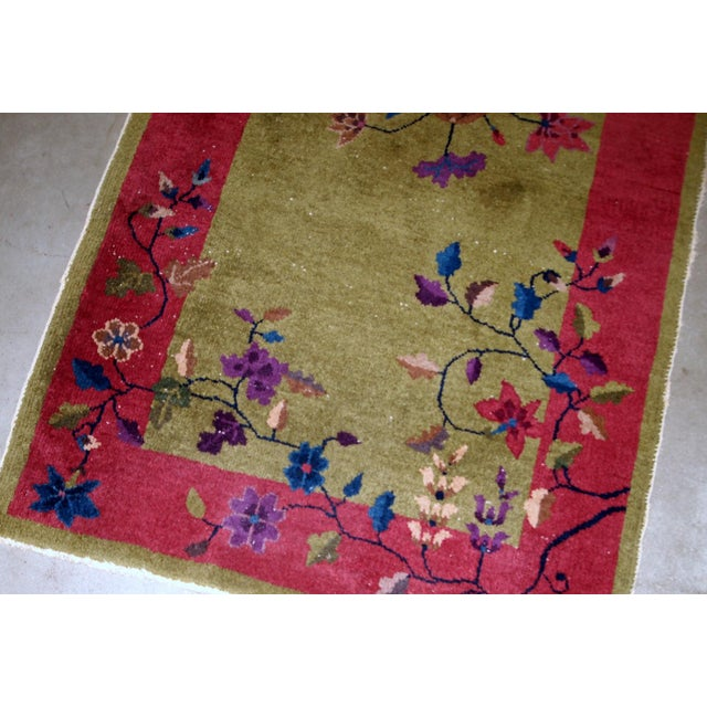 Handmade antique Art Deco Chinese rug in red and green shades. The rug is from 1920s in original good condition....