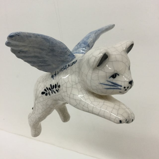 This lovely flying cat will make you smile. He can hang from a string anywhere you desire or he can sit on a shelf along...