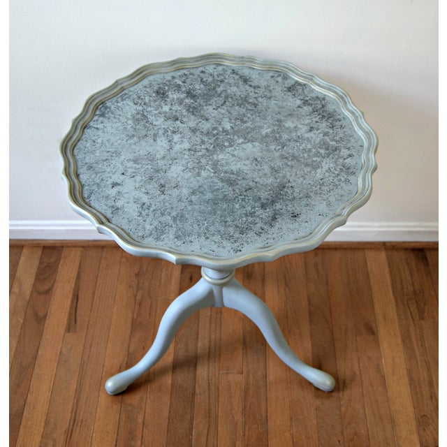 This table strikes a stunning silhouette with swooping legs, a fancy pedestal and pie-crust trim around the edges. Then we...