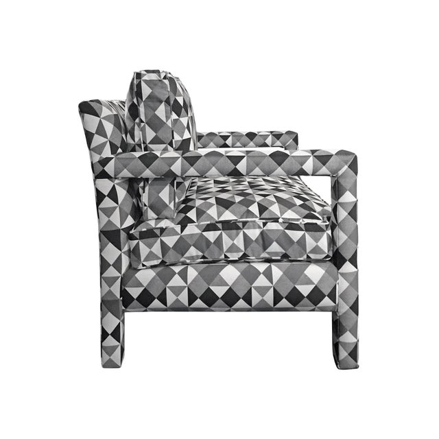 Parsons style lounge chair with cushions upholstered in a black, white, and grey geometric patterned fabric. USA, 1970s....