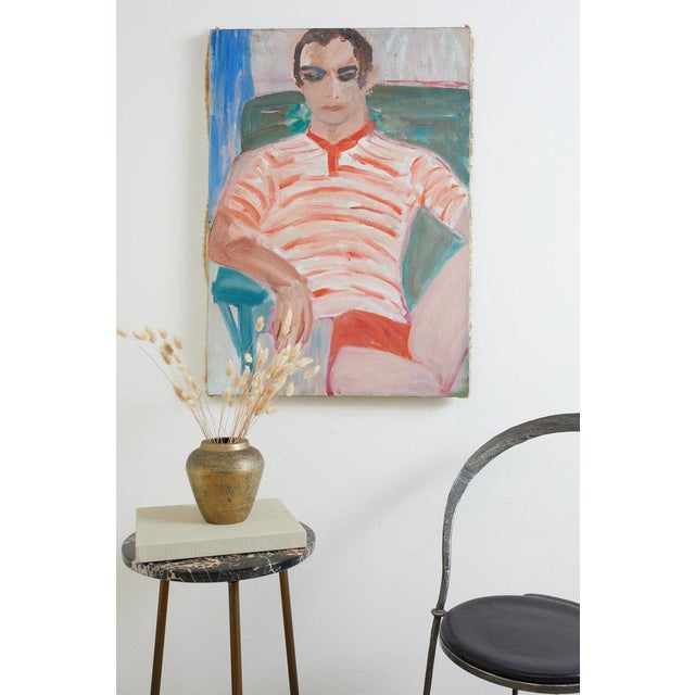Charming Mid-Century Modern oil on canvas painting depicting a young man in a lounge chair at a beach house. Colorful...