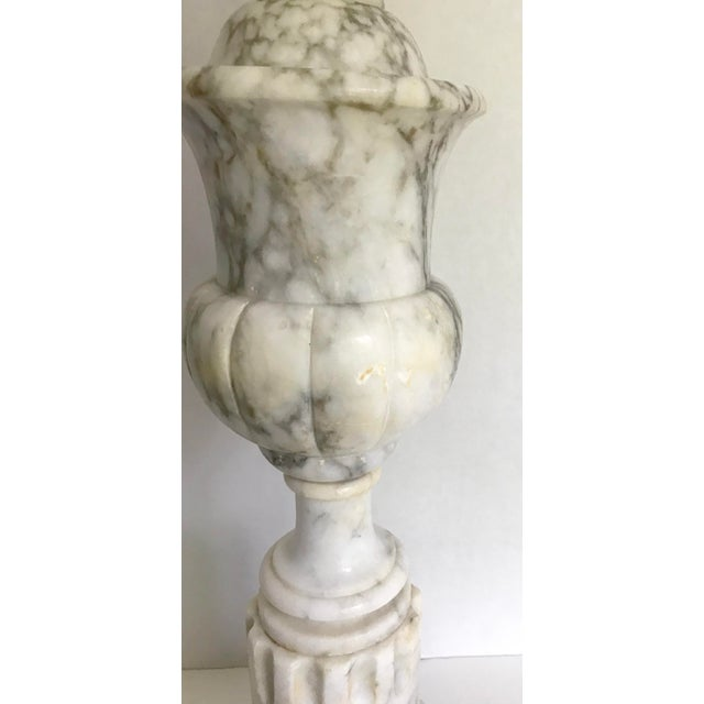 This is a carved lamp made of alabaster that looks exactly like marble! The colors are fabulous and can go in any decor;...