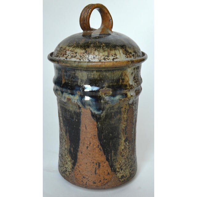 A large speckled stoneware ceramic lidded container to help organize your kitchen or office and give that Mid Century...
