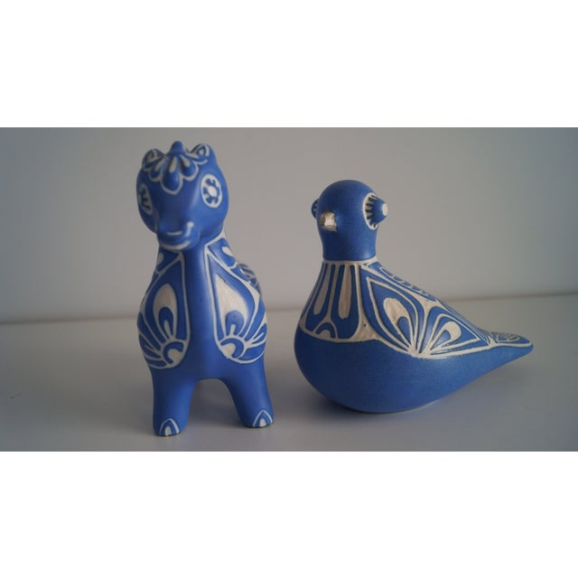 Handcrafted Animal Accessories. Blue and white with soft details. Comes as a pair.