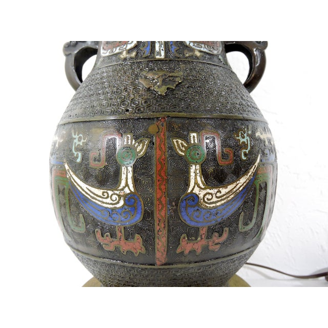 A unique and very curious antique Japanese archaic bronze 'Hu' form cloisonné table lamp with mythical or primitive form...