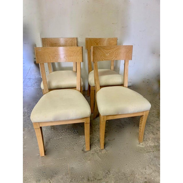 A wonderful set of four Cerused oak chairs, all heavy and in good condition. The seats are currently upholstered in a...