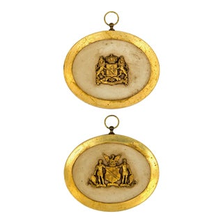 Gilded Coats of Arms in Oval Displays, a Pair For Sale