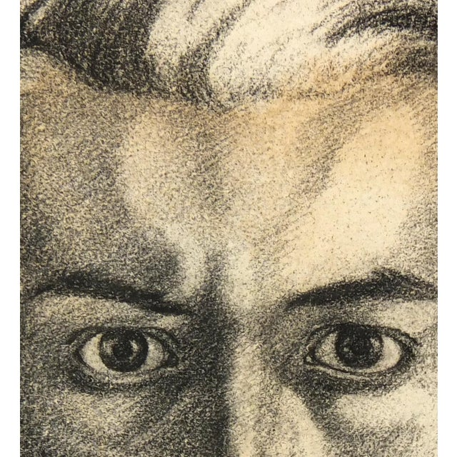 French pencil drawing by artist Etienne Dumesnil of a man's intense gaze, circa 1950. Displayed on a white mat with a gold...