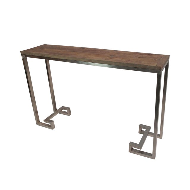 Modern design coupled with vintage charm is what you get with this stunning console table made from reclaimed wood and...