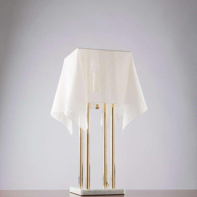 """""""Nefer"""" table lamp by Kazuide Takahama for Sirrah. White marble base, support in gold plated metal and fabric shade. The..."""