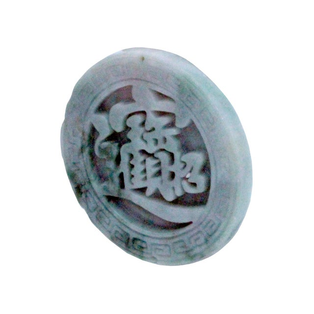 This beautiful round shape jade pendant is carved from natural untreated jade, the motif of this pendant is a Chinese word...