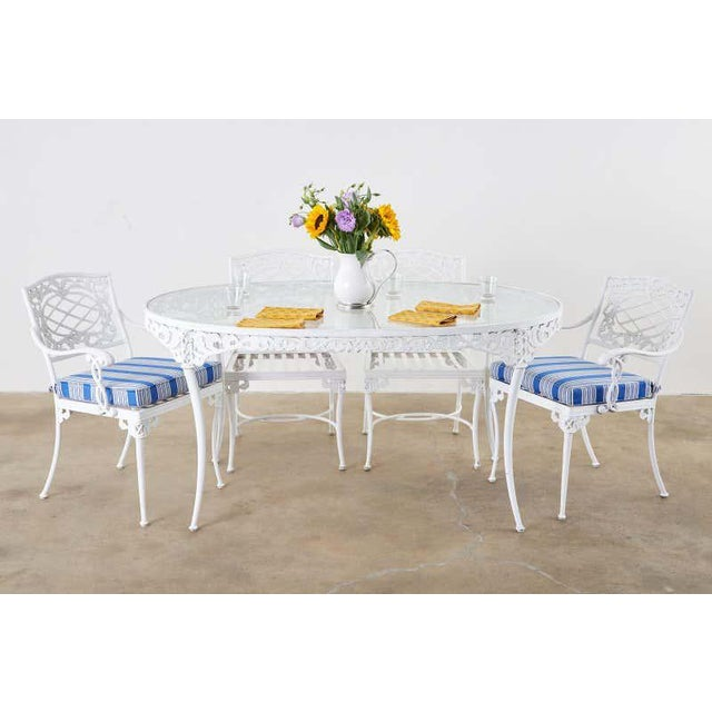 """Stately patio and garden dining set made in the neoclassical taste by Brown Jordan known as the """"Elegance"""" design. The set..."""