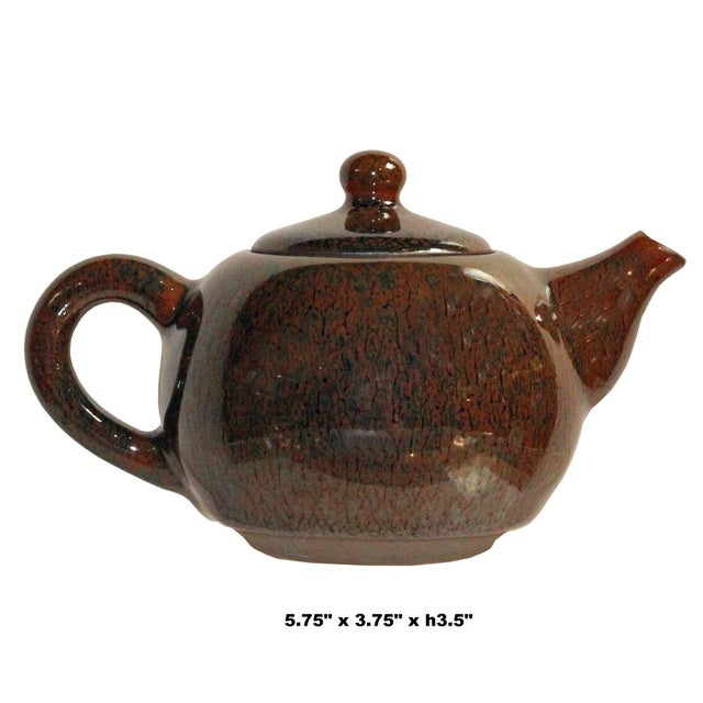 This is a nicely handmade teapot in Brown and bronze black marks finish. In Jianyang, Jiankou tea set with a small mouth,...