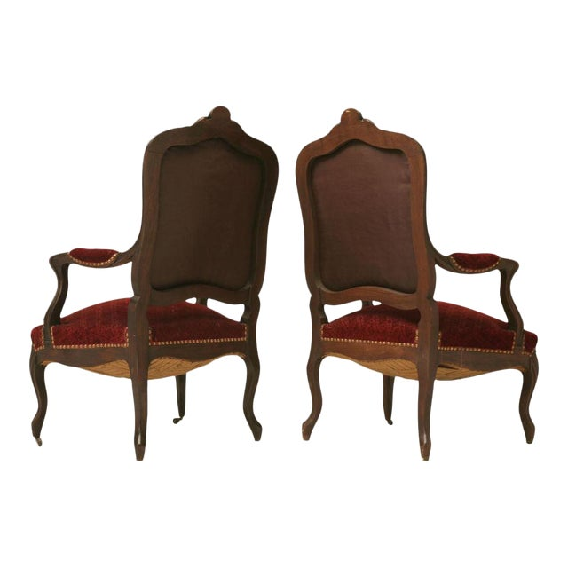 Carved Antique French Louis XV Walnut Fauteuils - A Pair For Sale