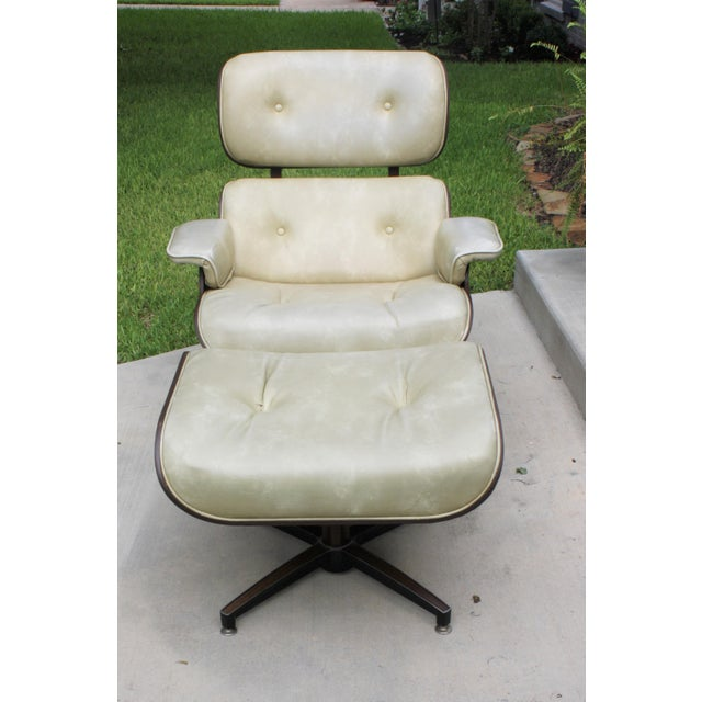 Mid-Century Modern Eames-Style Naugahyde Upholstered Walnut Laminated Lounge Chair and Ottoman -The upholstery is...