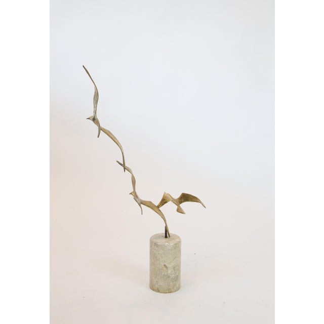 Mid Century solid brass Brutalist birds in flight sculpture on granite plinth. 1960's vintage and may be signed but if so...