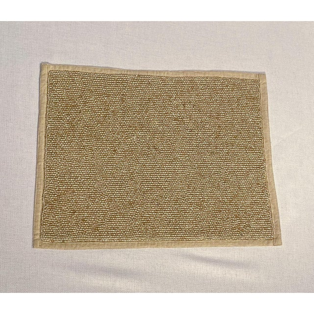 Beautiful natural linen placemats with hand-sewn glass bead field. Make any table festive and fun. By Dransfield & Ross...