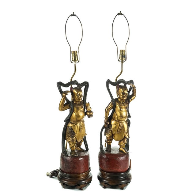 Offered is a pair of antique Chinese 19th-century carved gilt wood figural devil figurine lamps. These wicked styling...
