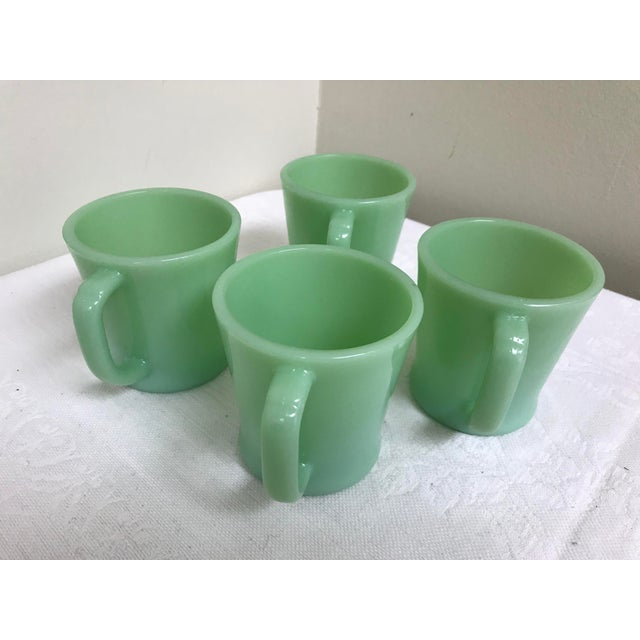 Excellent set of vintage Fire-King jadeite mugs with D handles. Bottom is marked Fire-King Oven 14. No chips or cracks,...