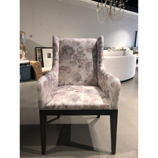 The Tempe Arm Chair is a first quality market sample that features a pink patterned fabric with a dark slate finish.