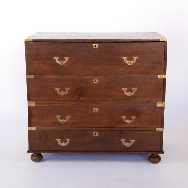 Handsome Teak Secretaire Campaign Chest with ornate flush falling brass pulls, inset brass supports and brass carrying...