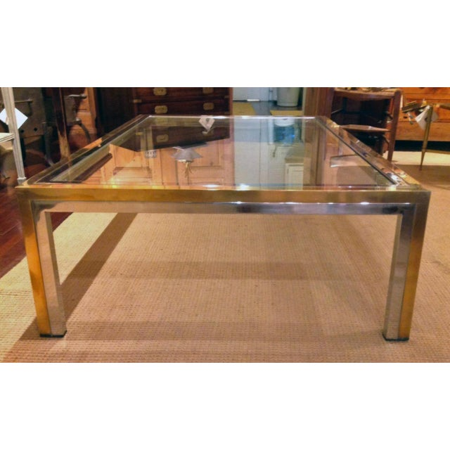 Romeo Rega brass, chrome and glass top coffee table in very good condition. Mid-century Modern Italian.