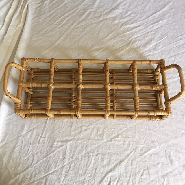 Bamboo caddy / carrier. Holds 10 glasses. I imagine this with cocktails served at a tailgate party or another use out door...