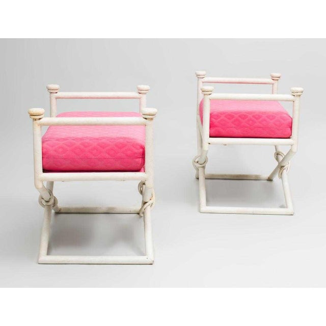 Pair of Hollywood Regency X-base benches with painted metal frames.