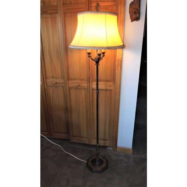 Here is a stunning Victorian floor lamp. Made of Iron and brass, it casts a beautiful glow. Perfect for Parlor, den or...
