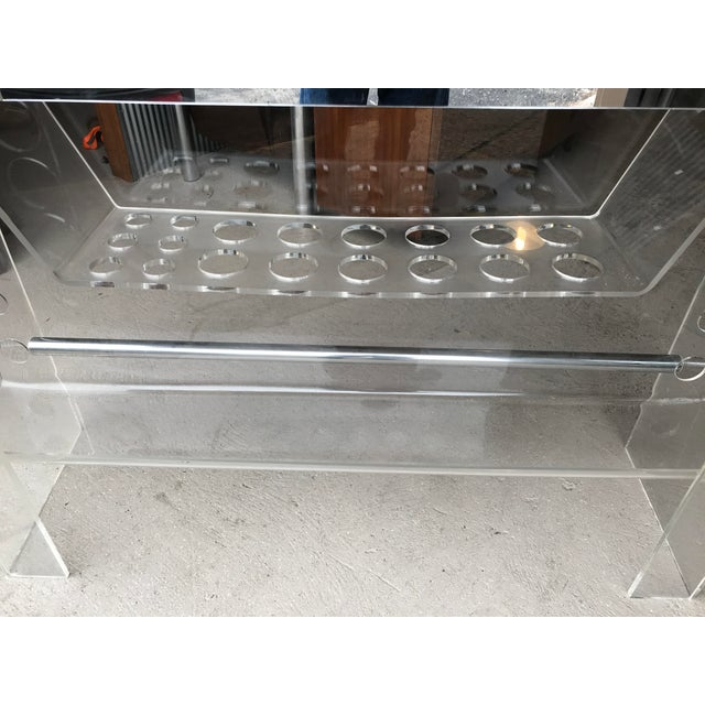 Lucite ghost bar by Hill Manufacturing. In good vintage condition, with some wear and minor scratches. One draw, holds ten...