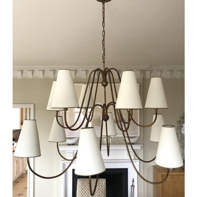 Jean Royere documented twelve light gold leaf metal chandelier