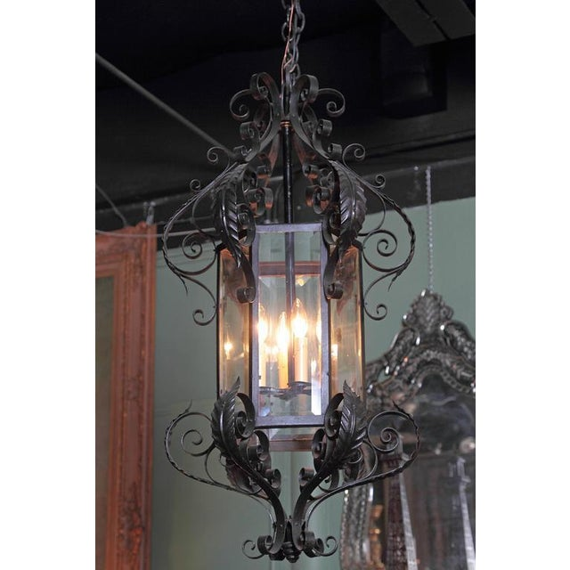 This elegant, hexagonal iron lantern from France, circa 1900 makes a rustic, antique statement. With six sides, beveled...