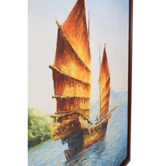 """Newly framed in a solid walnut wood floater frame, this original oil painting on stretched canvas depicts a Chinese """"Junk""""..."""