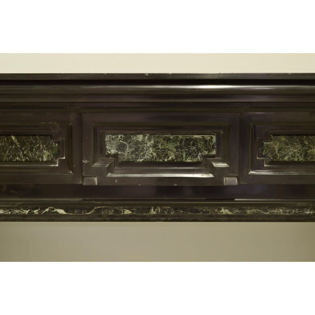 "Monumental Dutch mantelpiece from the 19th century. Beautiful deep black Belgian marble with green (""vert de mere"")..."