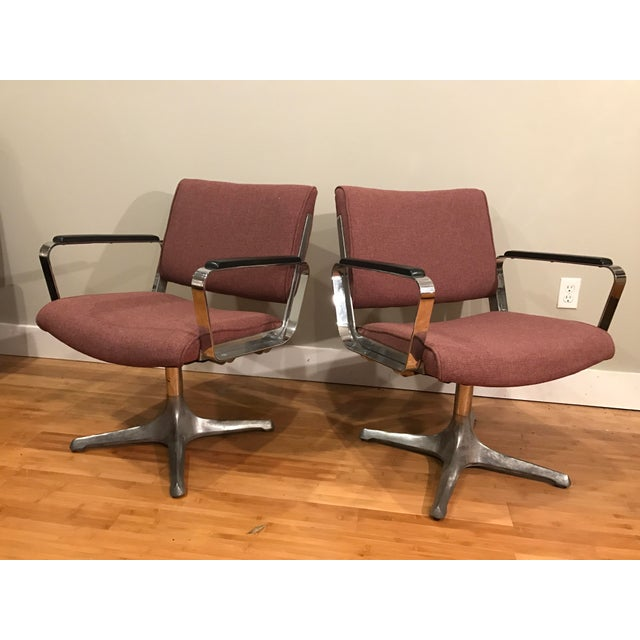 Pair of super solid chrome chairs. Similar to Eames aluminum group or management but no markings. Thick, heavy chrome arms...