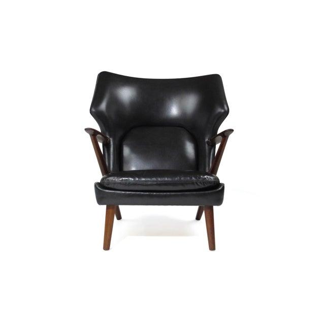 Midcentury lounge chair designed by Kurt Olsen for Slagelse Mobelvaerk, Model 221. Rare rosewood frame with sculpted wide...