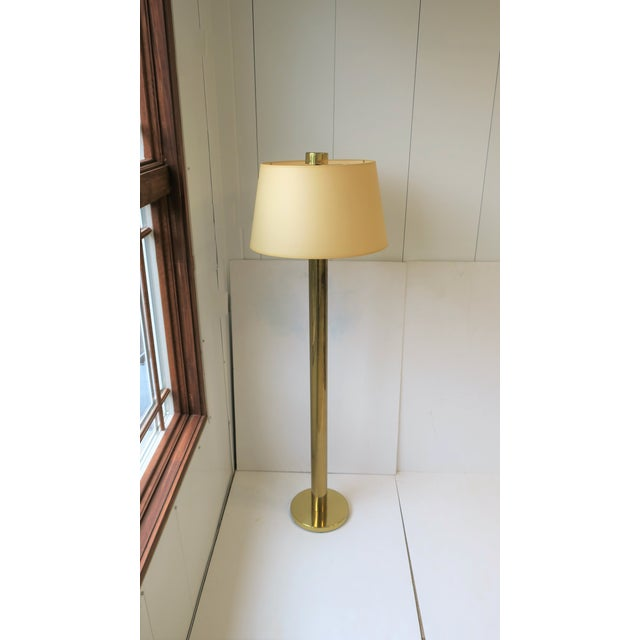 "A 1970s Modern brass floor lamp by Koch and Lowey. Floor lamp has tubular neck (2.75"" diameter), round base, and a large..."